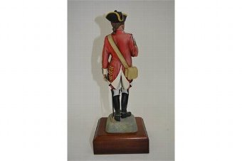 Antique finely detailed model depicting an officer of the British Cavalry atop a rock