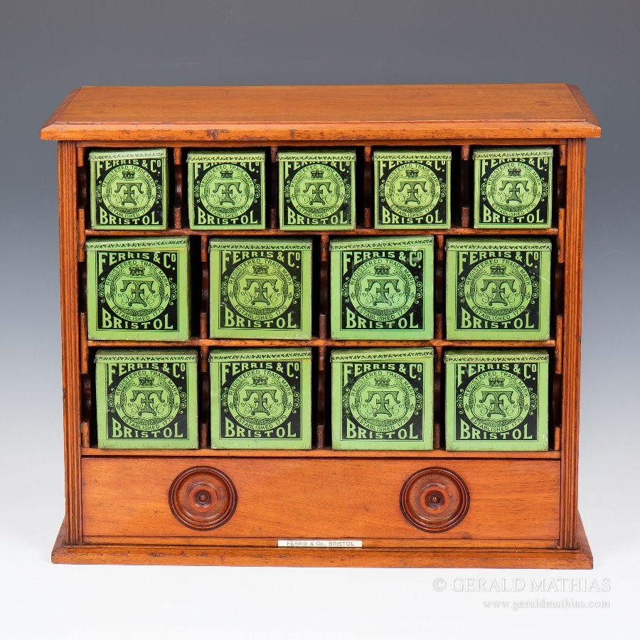 #9910 Ferris & Co. A Late 19th Century Mahogany Cabinet of Thirteen Tins for Surgical Dressings.