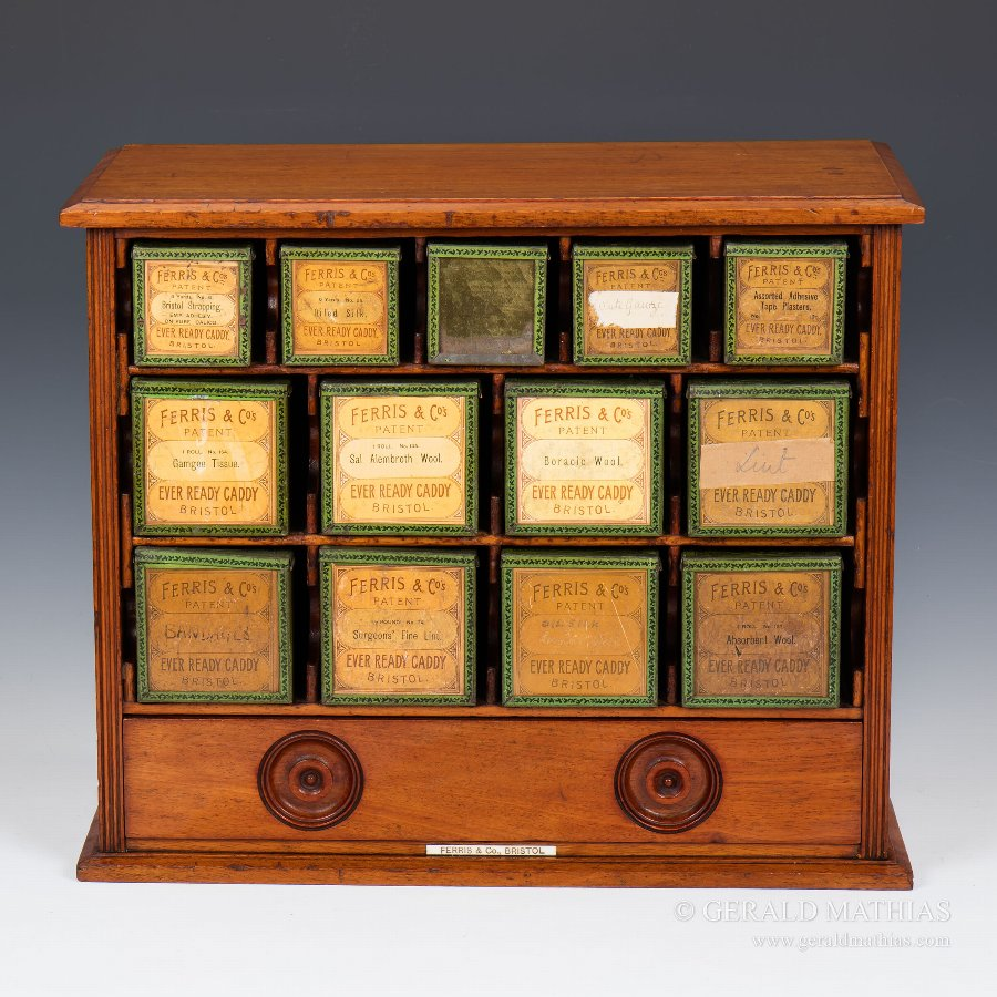 Antique #9910 Ferris & Co. A Late 19th Century Mahogany Cabinet of Thirteen Tins for Surgical Dressings.