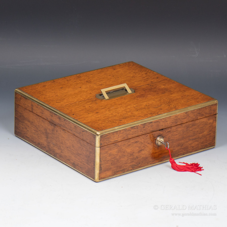 #9945 An Early 20th Century Brass Edged Table Box with Red Silk Velvet Lining.