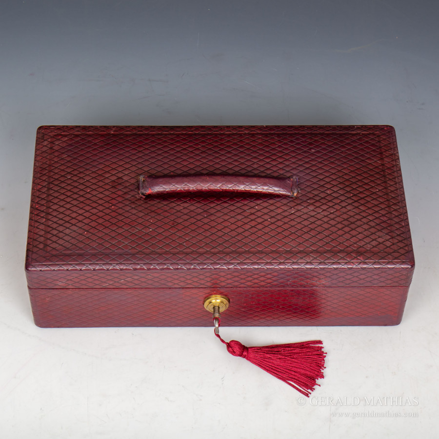 #9960 Peck & Son. A George V Period Burgundy Leather Box with Bramah Lock