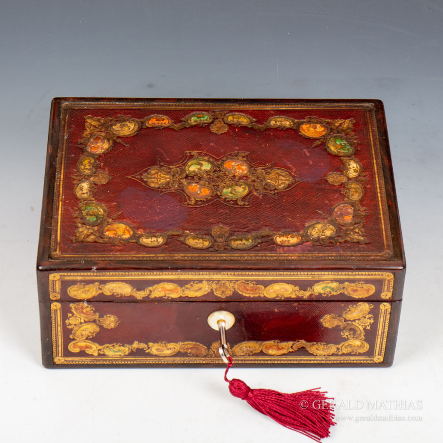 #9982 A Mid 19th Century Rosewood Box with Decorative Foliate Morocco Leather Panels.