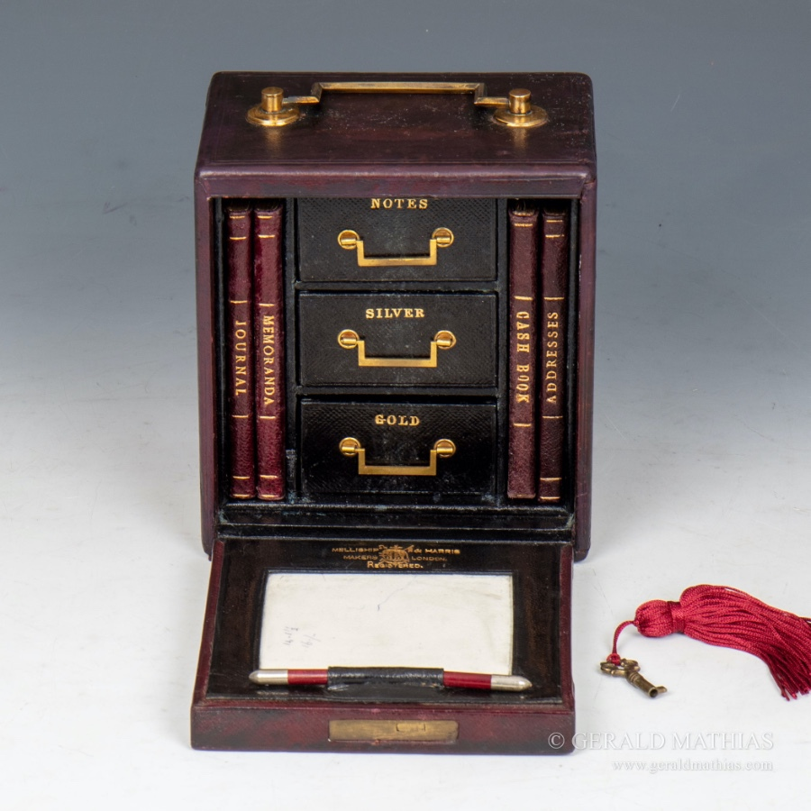#10010 Melliship & Harris A Miniature Burgundy Leather Safe with Three Drawers and Four Books.