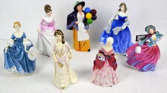 Antique Seven Doulton figurines including HN 4530, 3608, 1587, 2935, 2335, 3867, 4716 in box