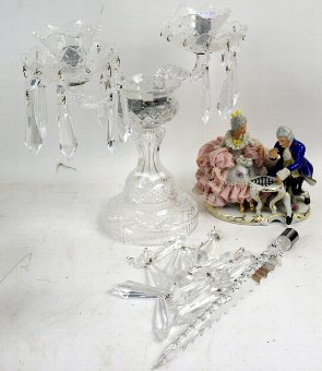 Antique A 20th century two branch crystal candelabra and a porcelain lace work group figure. (2)