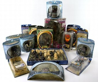 Antique Lord of the Rings - Character chess set and fourteen boxed Toy Biz promotional toys and figures. (16)
