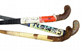 Antique St Trinian's (2007)- Collection of hockey sticks in khaki bag from the film, 98cm high.