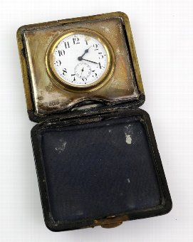 Antique Silver fronted and leather cased folding travel clock by Boots Pure Drug co, Birmingham 1911