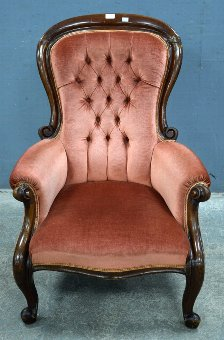 Antique 19th century mahogany framed armchair upholstered in pink on cabriole legs.