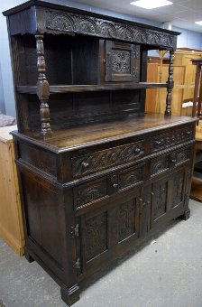 Antique Early 20th century oak dresser with earlier applied carved decoration,