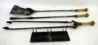 Antique 19th century set of brass and metal fire irons.