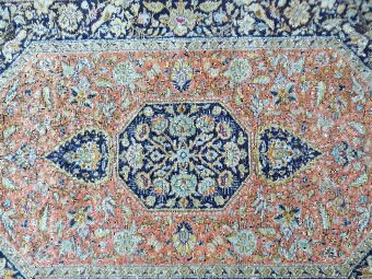 Antique Persian silk blue ground rug with multiple borders, the centre with a shaped medallion 156cm x 107cm