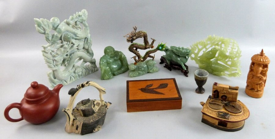 Collection of oriental items including hard stone carvings, enamelled dragon and redware teapot.