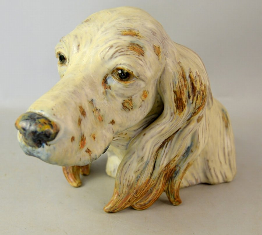 Lladro figure naturalistically modelled as the head of a gun dog, washed in oxide glazes, 20cm high.