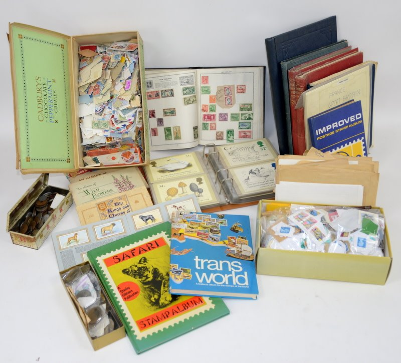 A collection of stamps, coins, collector's cards and first day covers. (qty)