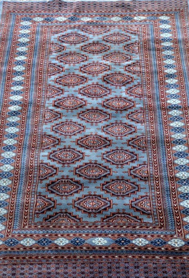 Persian grey/blue ground rug, with numerous geometric medallions and multiple border