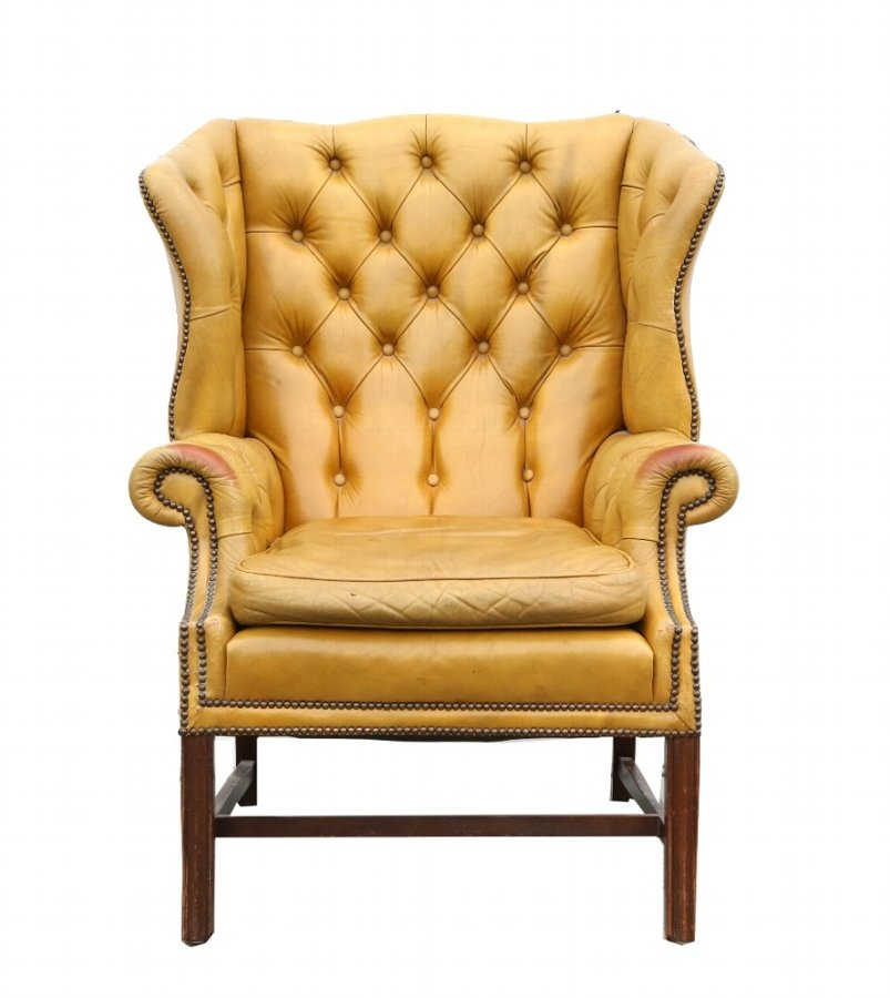 19th century style yellow leather button back winged arm chair