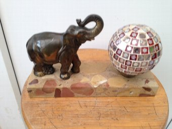 Antique Art-deco 25cm by 16cm by 5cm small side table lamp with an elephant standing on a marble base next to a multi-mirrored ball lamp shade