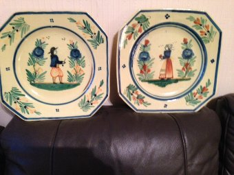 Antique A pair of early 19th century French Quimper 25cm ceramic plates, one depicts a male figure the other a female.