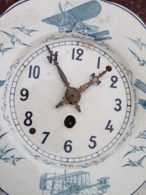 French 1920's Jaz crackle finished ceramic faced wall clock, with transfer print decoration of th...