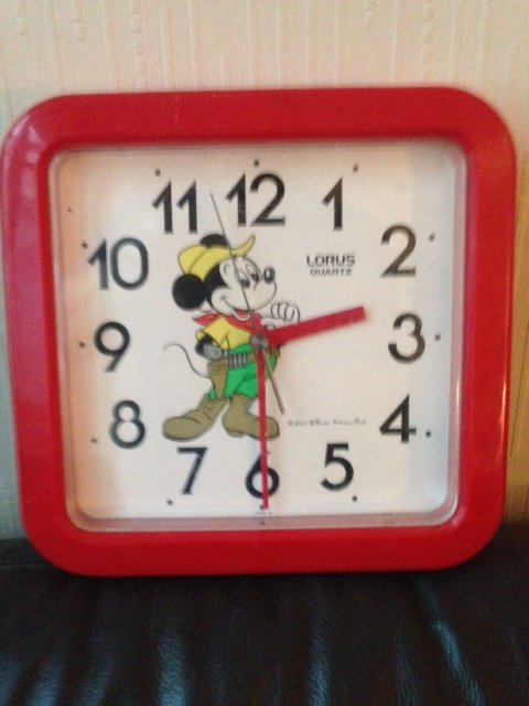 A 1960's red plastic and whited faced Walt Disney productions Micky Mouse made in Japan Lorus battery operated quarts wall clock.