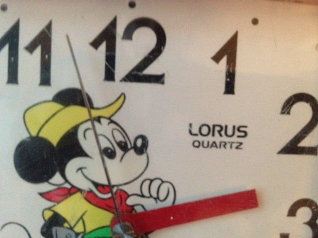 Antique 1960's red plastic and whited faced Walt Disney productions Micky Mouse made in Japan Lorus battery operated quarts wall clock.