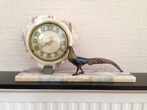 Art-deco 40cm by 22cm by 9cm marble mantlepiece clock shield shaped face with Arabic numerals and cold painted small figure of a pheasant