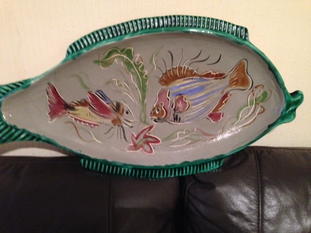 Antique A French mid-20th century fish plate 61cm by 31cm flamboyantly decorated in a multitude of colours and two images of fish.