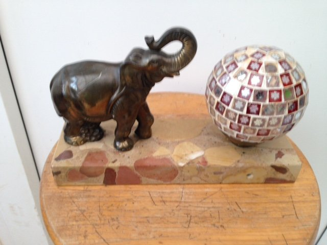 Art-deco 25cm by 16cm by 5cm small side table lamp with an elephant standing on a marble base next to a multi-mirrored ball lamp shade