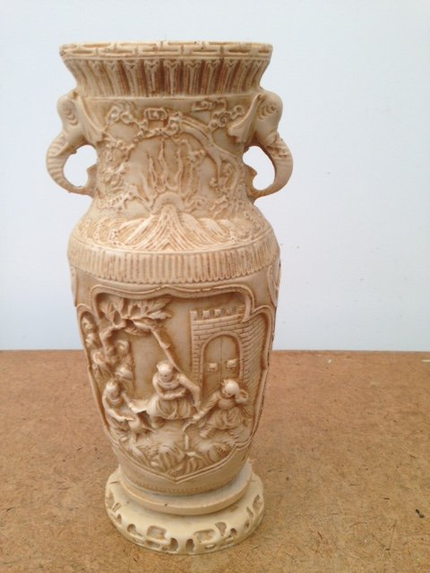 This is a late 19th early 20th century Chinese 27cm by 7cm vase made from a resin composite copying the look of ivory