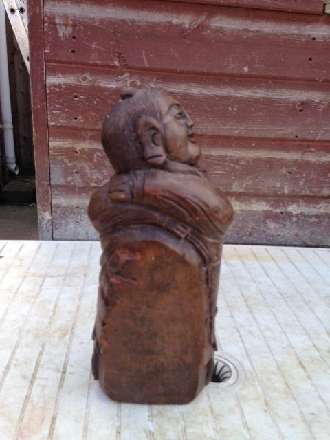 Antique A late 19th early 20th century Chinese buddha wooden book-end craved from bamboo, 30cm by 9 cm in diameter