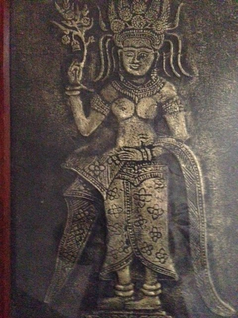 Very early Indian 28cm by 45cm artwork of a goddess portrayed in raise gold on aged black cloth