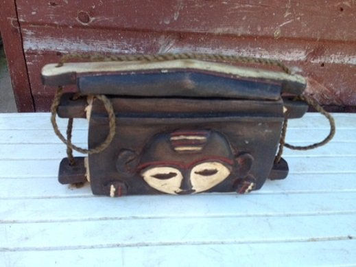 An authentic early to mid-20th century African tribal wooden carrier 23cm by 13cm