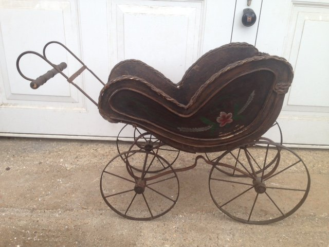 Rare and fine example of a late 19th early 20th century child's painted wooden dolls pram with a ...