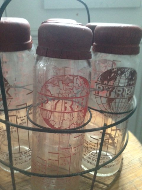 Set of 7 early 20th century Pyrex glass children's school milk bottles