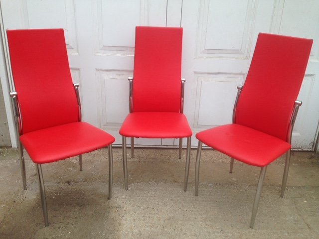 Set of three very sexy looking high-backed 1970's retro chairs, in fabulous red leatherette with chrome legs.
