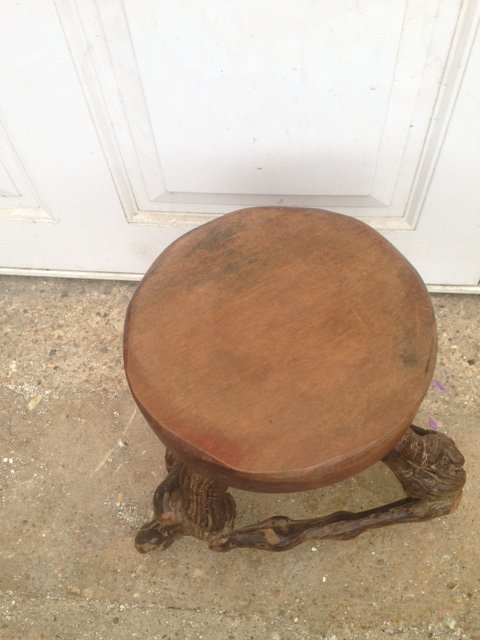 Antique A skilfully crafted and quite unusual early 20th century solid round topped wooden stool with vine root legs.