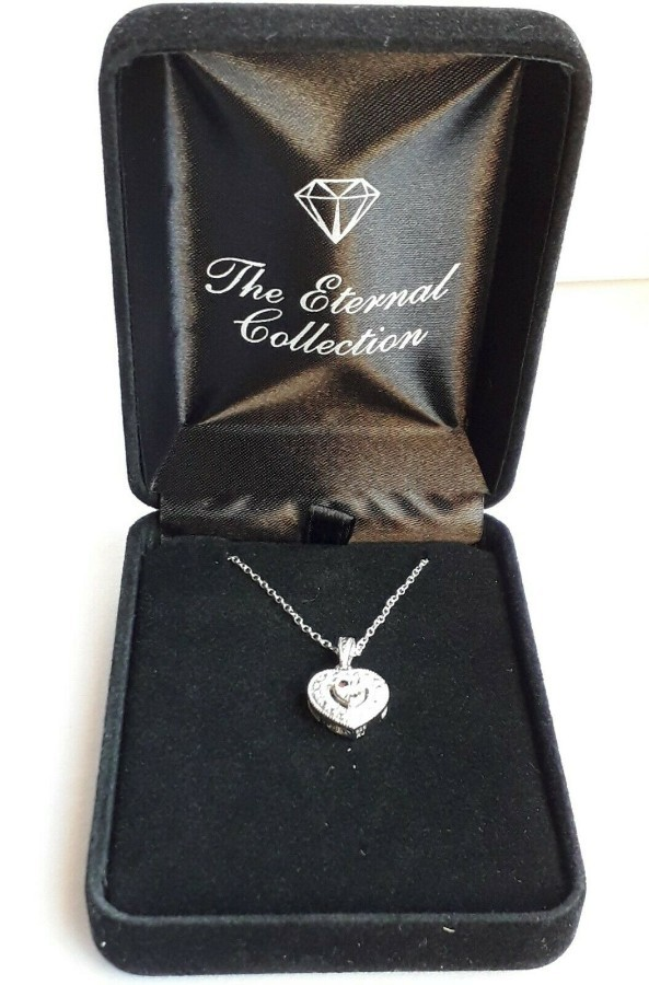 A Sterling Silver .925 Necklace and Diamond Pendant.