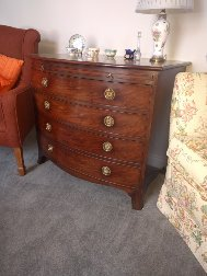 George III mahogany bowfront chest incorporating lead-lined wine cooler. c.1810
