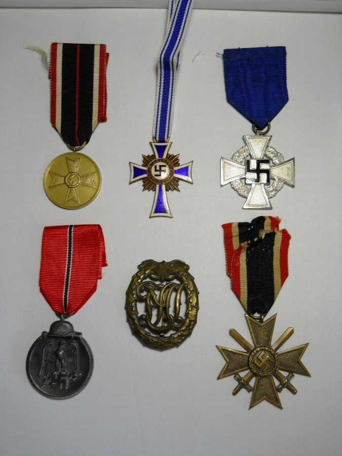 A UNIQUE SET OF WW2 GERMAN FAMILY MEDALS