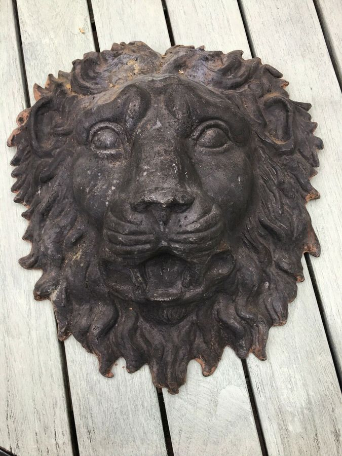 Antique A 20th century lead hanging wall ornament modelled as the face of a lion.