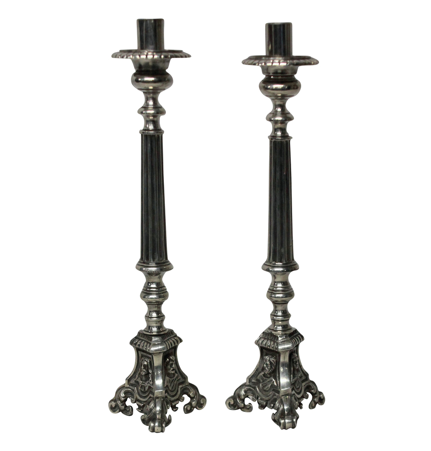 A PAIR OF SILVER PLATED CANDLESTICKS