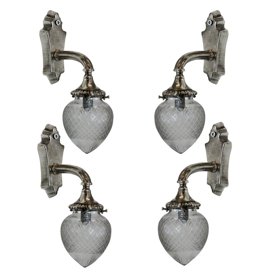 A SET OF FOUR SILVER BRACKET SCONCES
