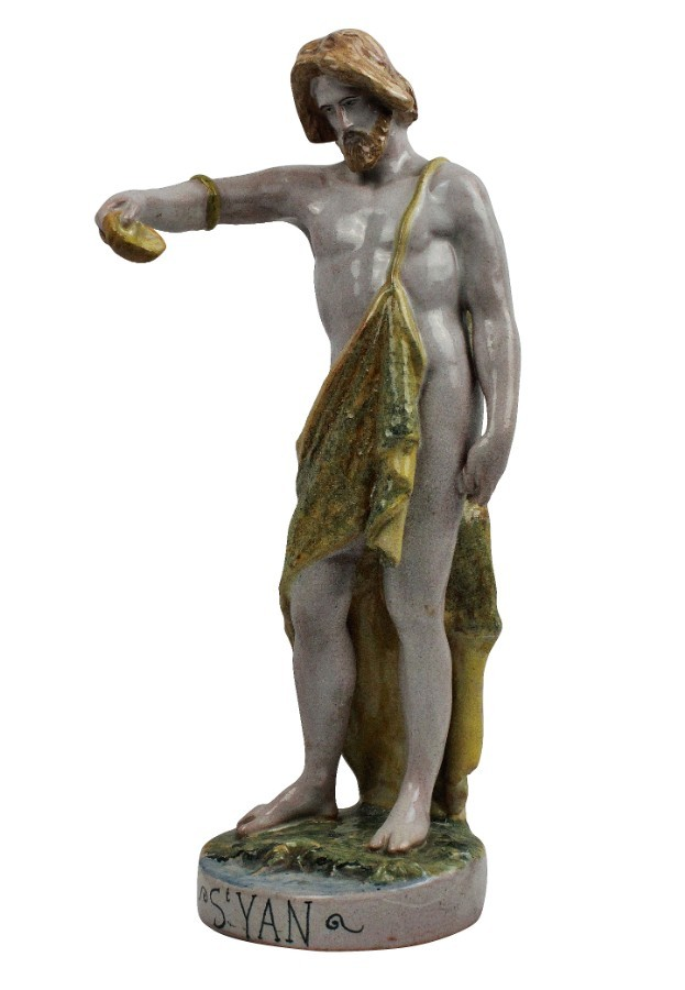 A SPANISH MAJOLICA STATUE OF ST JOHN THE BAPTIST
