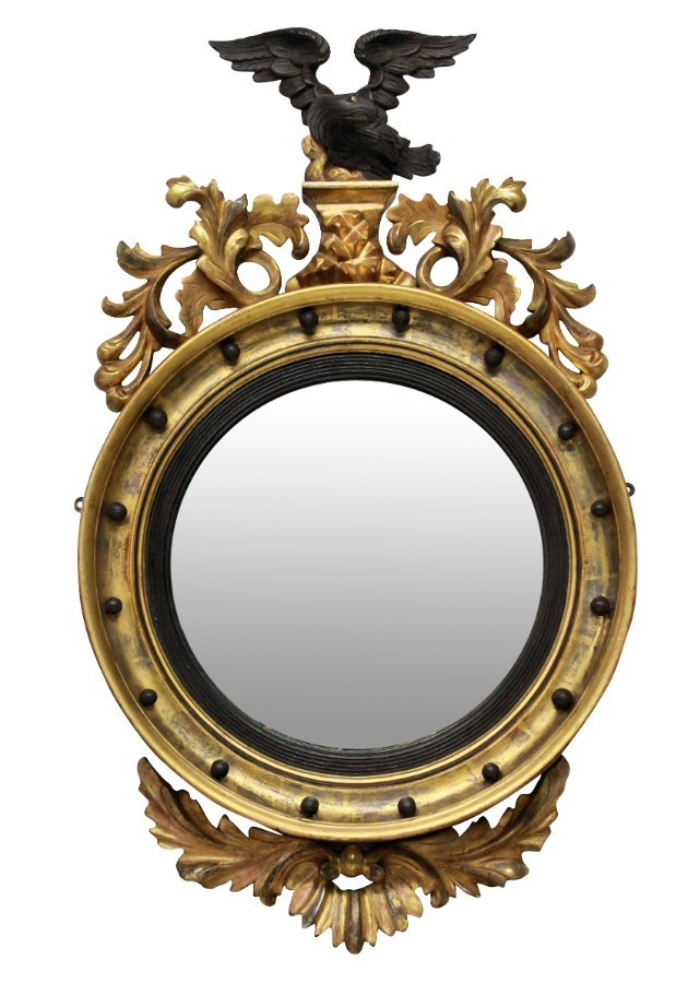 AN ENGLISH REGENCY CONVEX MIRROR