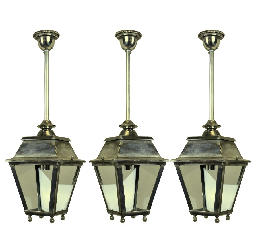 A SET OF THREE FRENCH SILVER HALL LANTERNS