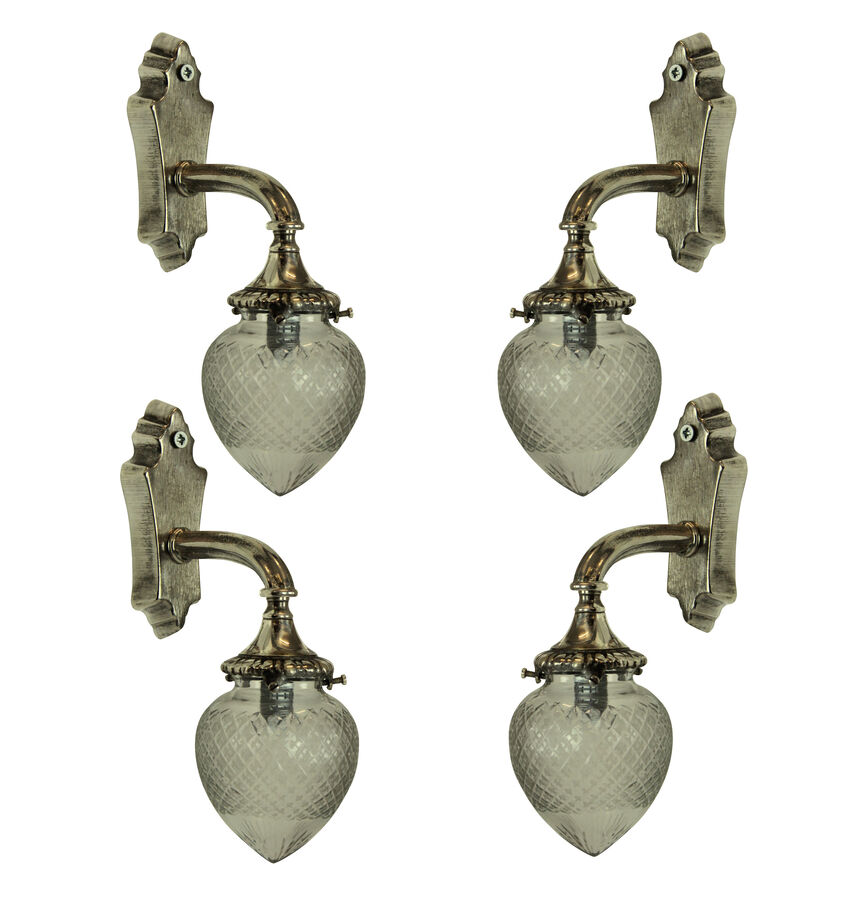Antique A SET OF FOUR SILVER BRACKET SCONCES
