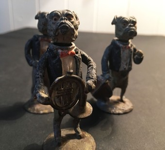 Antique Three early 20th century painted lead nodding bulldog figures.