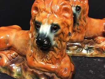 Antique A large pair of 19th Century Staffordshire recumbent lions.