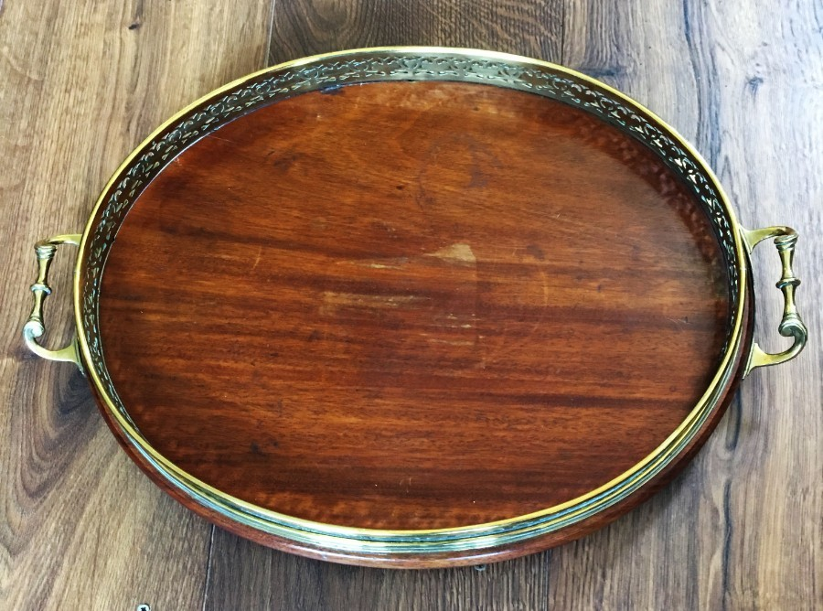 Antique A late 19th/early 20th Century mahogany and brass galleried serving tray.